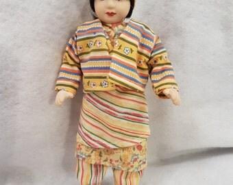 Porcelain small doll 22cm