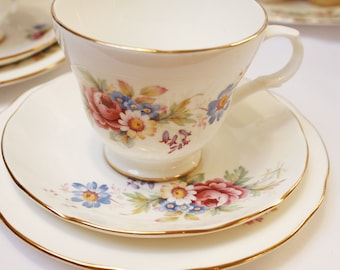 "Floral  ""Crown Trent"" bone china tea set: tea cup, saucer and tea plate. Such a pretty teaset."