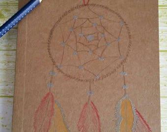 carnet avec lignes en kraft dessin attrape rêves