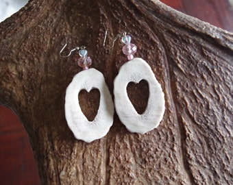 Show off the love! Chunky sculpted elk antler earrings with heart shaped carvings