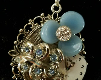 One of a kind assemblage collage necklace made with vintage jewelry in silver and blues with an old watch face! OOAK