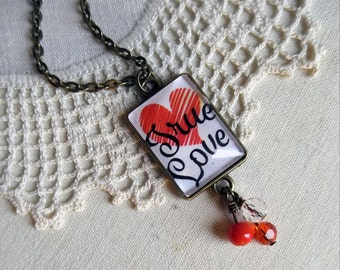 True Love Script necklace with playful bead tassle