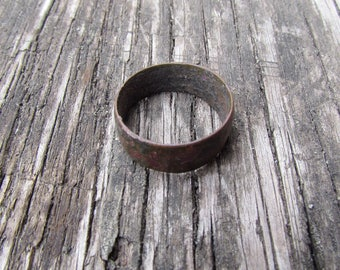 An old copper ring. Found a metal detector in an abandoned farm.