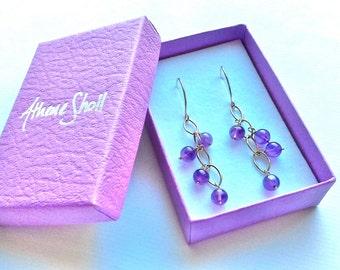 Handmade 9ct gold and amethyst waterfall earrings.