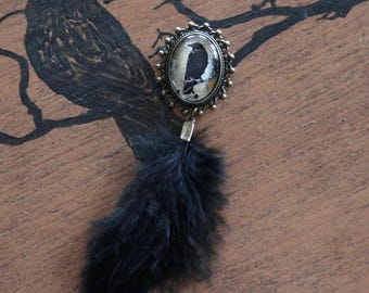 BALANCES cabochon Raven and black feather brooch