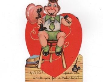 Vintage 1930s Valentine card. Boy on Telephone calling for a date. Mechanical moving picture 3 interchangeable heads!