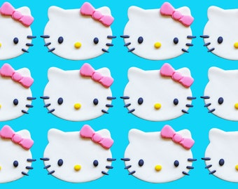 12 edible Hello Kitty cupcake toppers