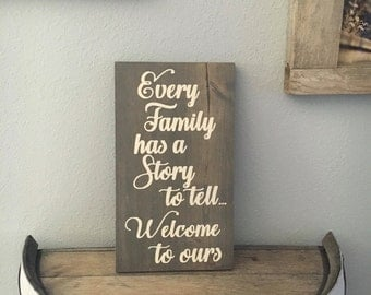 Every family has a story to tell welcome to ours sign