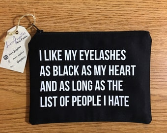 An 'I Like My Eyelashes As Black As My Heart And As Long As The List Of People I Hate' makeup bag