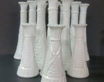 Milk glass bud vases. Star and dash pattern.  13 total.