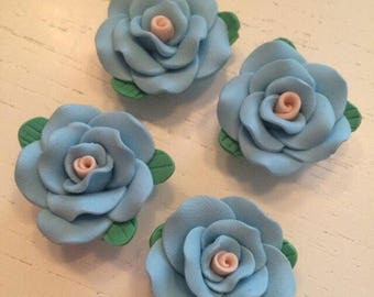 Lot 4 flowers in fimo by 25 mm