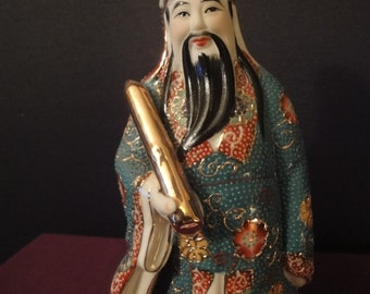 Chinese figurine of a scholar with a parchment  very colourful   height =20cm