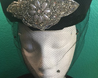 "Vintage 1950's Clover Lane Black"" top of head"" shinny straw with full face veil and pearl embellishment in front   35.00"