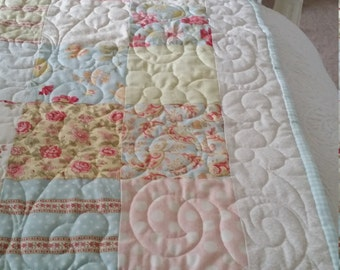 Cream, pink and turquoise patchwork baby quilt
