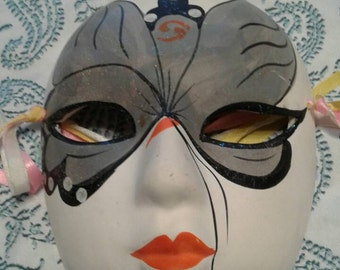 Vintage white ceramic Mardi gras mask