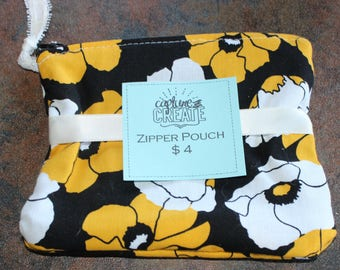 Black, White, and Yellow Floral Pouch