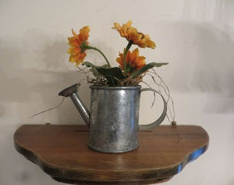 Miniature watering can with sunflowers