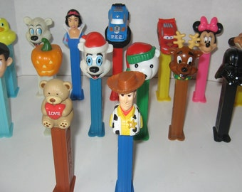 Lot of 16 Pez Dispensers- A lot of Disney-Glow Pumpkin, Christmas Bears, Darth Vader, Cars Characters and more