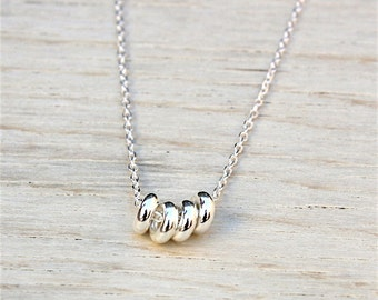 donuts in sterling silver on a chain necklace