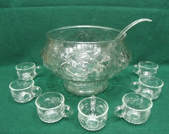 Glass punch bowl set with 7 cups and ladle.