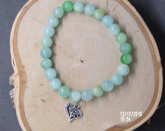 B1266 Small Jade Glass Beaded Bracelet with  metal Charm.