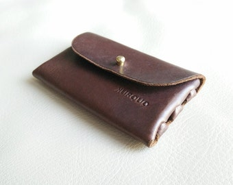 Leather purse for storing coins, headphones or small objects