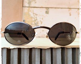 Occhiali da sole uomo ovale in metallo grigio avvolgente accattivante Sunglasses man oval gunmetal enveloping steampunk endearing Design ITA