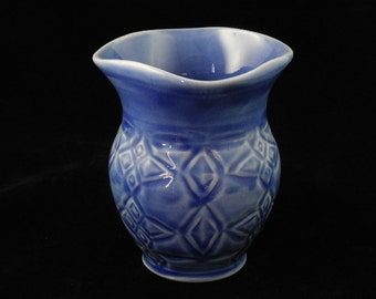 Porcelain, glossy blue celadon glaze.