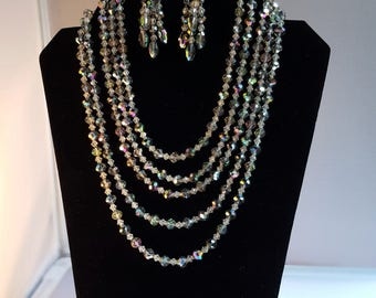Vintage crystal statement necklace and earrings. Retro glamor in 5 strands of sparkling vitrial crystals with dramatic drop earrings.