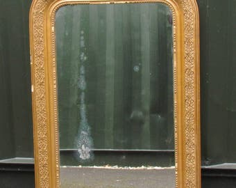 A very decorative Victorian gilt framed mirror. Lovely wear and patina