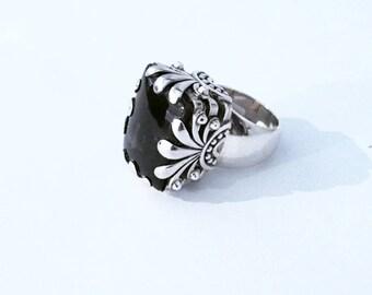 Big silver ring and Smokey Brown quartz