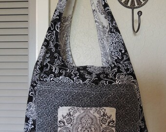Reversible sling bag in pretty black and white prints