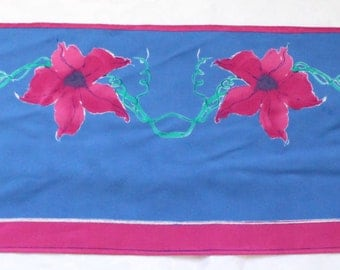 Vera Neumann Oblong Magenta and Teal Flower Scarf on Blue Background