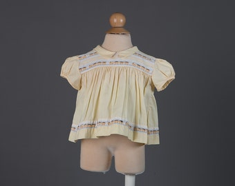 Vintage 1960s baby girl's yellow train top
