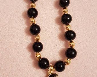 Black and gold cresent moon bead and charm bracelet