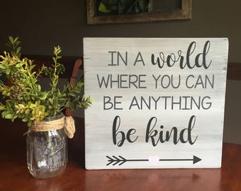 In a world where you can be anything be kind wooden sign