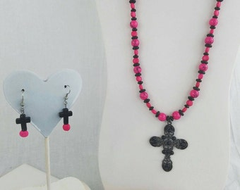 Pink and black beaded necklace with black cross, bracelet and earrings
