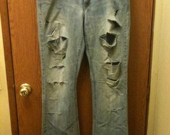 Women's slashed and studded blue rocker jeans, slashed and studded blue rocker jeans, size 16