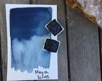 Half pan of handmade Maya blue watercolor paint