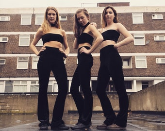 Black high-waisted flares with fur trim