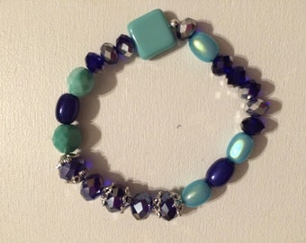 Square turquoise glass bead bracelet.