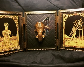 Mink skull with butterfly wing and HP Lovecraft tarot cards