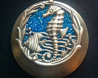 Silver seahorse pendant made into a refrigerator magnet
