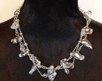 Handmade exclusive necklace with earrings in grey-silver shades made from wild Baroque pearls