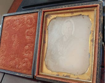 Sixth-Plate Daguerreotype in Whole Case of a Woman in a Bonnet Holding a Book