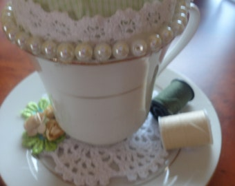 Tea cup pin cushions.