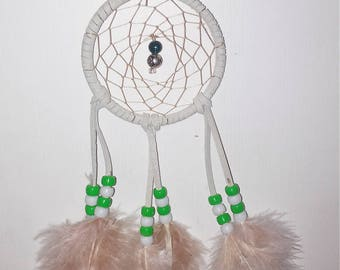 green and sand dream catcher.