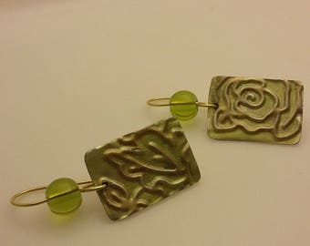 Peridot green earrings with accent bead