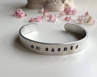 Aluminum cuff bracelet Om Shanti
