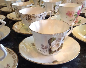 100 English bone china cups and saucers. Vintage